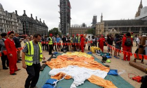 Demonstrators prepare to inflate a blimp portraying U.S. President Donald Trump, in Parliament Square, during the visit by Trump and First Lady Melania Trump in London