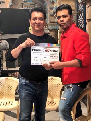 "The shooting for filmmaker Karan Johar's next production venture ""Kalank"" has begun. Actor Varun Dhawan, who is collaborating with Karan for the fourth time, shared a photograph of the filmmaker with producer Sajid Nadiadwala. They posed with the film's clapboard. ""It begins. 'Kalank',"" he captioned the image. The film also stars Sanjay Dutt, Aditya Roy Kapur and Sonakshi Sinha. Abhishek Varman will direct the ""epic drama"", which will hit screens on April 19, 2019. The film will be produced by Karan, Nadiadwala, Hiroo Yash Johar and Apoorva Mehta. It is co-produced by Fox Star Studios."