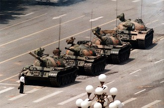 Tank Man of Tiananmen: The iconic image of a lone man stopping a column of battle tanks in Beijing on June 5, 1989.