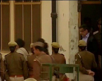 Rajesh Talwar escorted out of the court on Tuesday