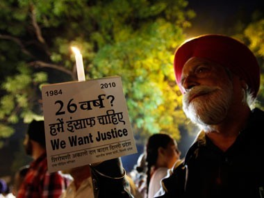 Protesters hold a candle light vigil against what they say was the government's failure to punish the guilty in the1984 anti-Sikh riots.