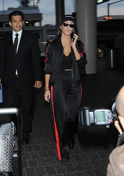Kourtney Kardashian,Kourtney Kardashian spotted in black and red tracksuit,Kourtney Kardashian bikini pics,Kourtney Kardashian bikini images,Kourtney Kardashian bikini stills,Kourtney Kardashian curves,Kourtney Kardashian curves pics,Kourtney Kardashian f
