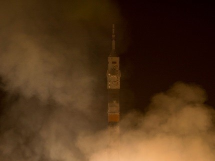 The Soyuz TMA-12M rocket launches from Baikonur Cosmodrome in Kazakhstan on 26 March