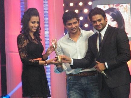 Actress Trisha receiving award from actors Madhavan and Jiiva