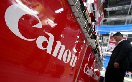 A logo of Canon Inc is pictured at an electronics store in Tokyo October 23, 2012.