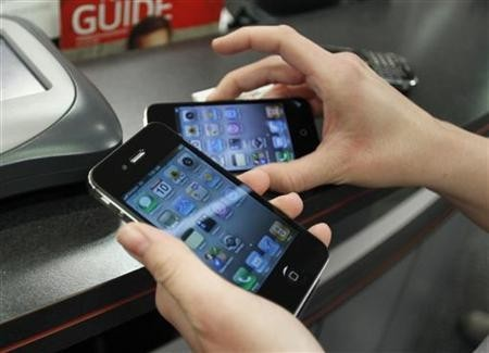 A customer holds iPhones she purchased shortly after the phone went on sale with the Verizon Wireless network in Boca Raton, Florida February 10, 2011.