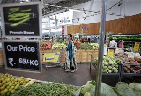 Women shop at a retail supermarket in Mumbai