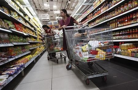 Women shop for instant noodles at a retail supermarket in Mumbai March 16, 2012.