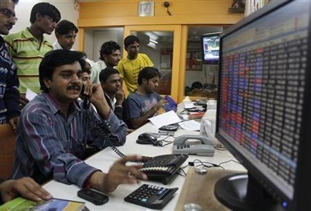 A trader works at a stock brokerage in Ahmedabad November 26, 2010.