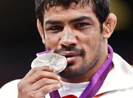 Sushil Kumar poses with his silver medal at the podium of the Men's 66Kg Freestyle wrestling at the ExCel venue during the London 2012 Olympic Games August 12, 2012.