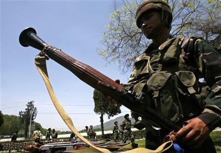 An Indian army soldier displays a seized rocket propelled grenades launcher (RPGL) during a news conference inside a military garrison in Srinagar April 25, 2009.