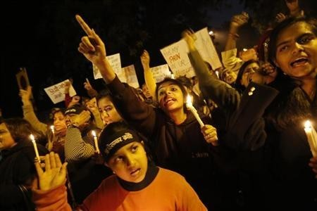 Demonstrators shout slogans and raise their hands during a candlelight march for a gang rape victim, who was assaulted in New Delhi January 16, 2013.