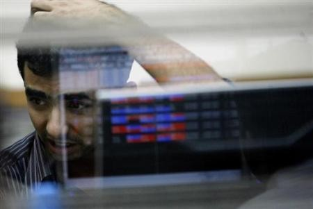A broker reacts while trading at a stock brokerage firm in Mumbai November 11, 2008.