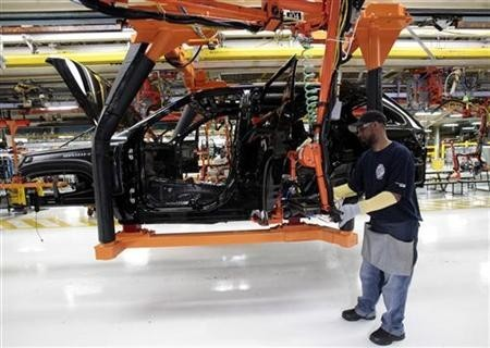 Chrysler auto assembly worker Michael Ricks works on the assembly line attaching doors to the all-new 2011 Jeep Cherokee's at the Jefferson North Assembly Plant in Detroit,