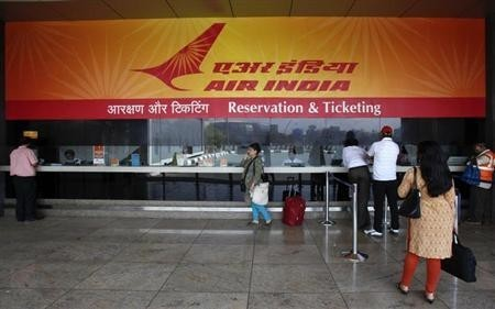Customers stand at an Air India reservation office at the domestic airport in Mumbai
