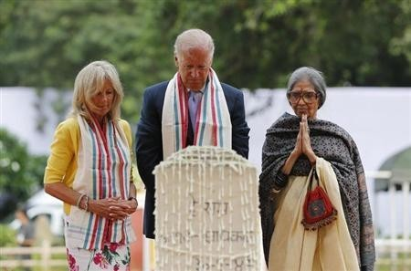 U.S. Vice President Joe Biden (C), his wife Jill (L), and Tara Gandhi, the granddaughter of Mahatma Gandhi, pay homage at the Mahatma Gandhi memorial at Gandhi Smriti, in New Delhi July 22, 2013. (Reuters)