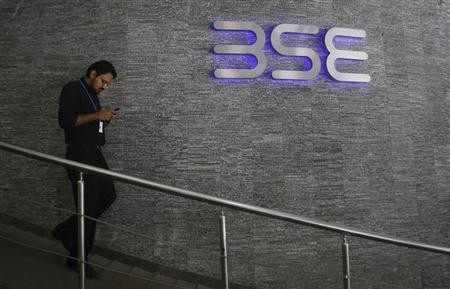 An employee walks out of the Bombay Stock Exchange (BSE) building in Mumbai August 22, 2013.