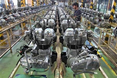 A worker assembles an engine inside the Royal Enfield motorcycle factory in Chennai April 6, 2012.