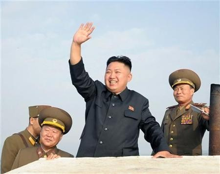 North Korean leader Kim Jong-Un (C) waves as he visits military units