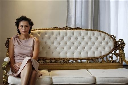 Gigi Chao, the daughter of Hong Kong property tycoon Cecil Chao Sze-tsung, poses at the conference room of her office in Hong Kong September 27, 2012.