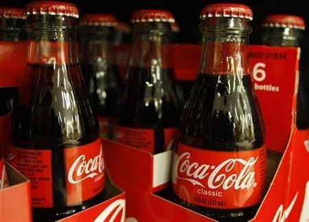 Bottles of Coca-Cola sit on a supermarket shelf in Gilbert, Arizona October 20, 2009.