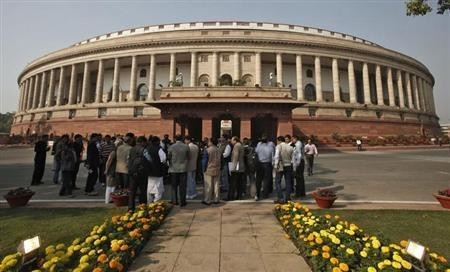 People stand in front of the Indian parliament building (representational picture)