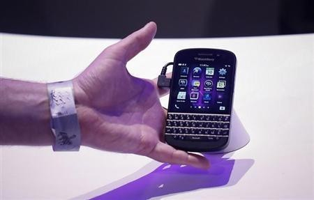 An attendee reaches out to grab a newly launched Research in Motion (RIM) Blackberry 10 device in New York January 30, 2013.