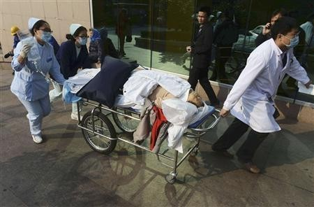 An injured woman being rushed to the hospital in China