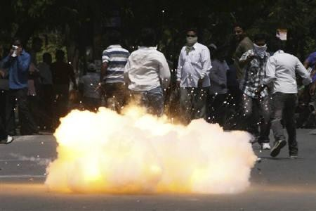 A tear gas shell fired by riot police explodes near pro-Telengana supporters during a demonstration in Hyderabad March 10, 2011(Reuters/Krishnendu Halder)