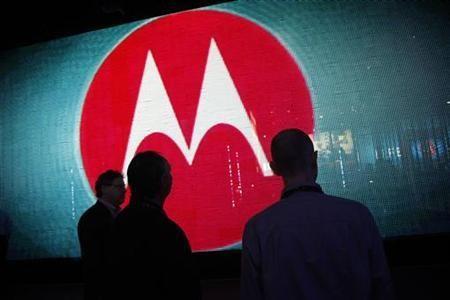 Visitors look at a video display at the Motorola booth