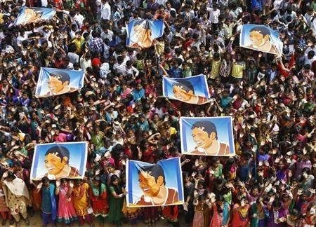 School children hold posters for Sachin Tendulkar in Chennai during his last test match