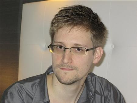 U.S. National Security Agency whistleblower Edward Snowden, an analyst with a U.S. defence contractor, is seen in this still image taken from a video during an interview with the Guardian in his hotel room in Hong Kong June 6, 2013.(Reuters/Courtesy of The Guardian/Glenn Greenwald/Laura Poitras/Handout)