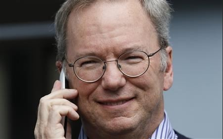 Eric Schmidt holding a yet to be released Moto X phone