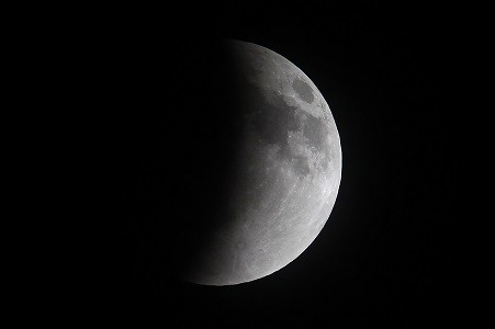 A shadow falls on the moon as it undergoes a total lunar eclipse as seen from Mexico City (Reuters)