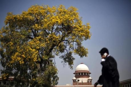 A lawyer walks past outside Indian Supreme Court