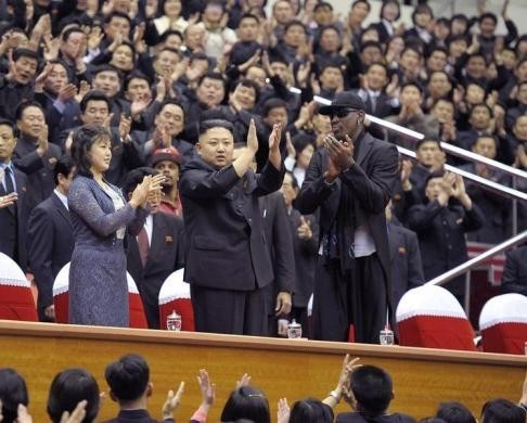 North Korean leader Kim Jong-Un (C), his wife Ri Sol-Ju (L) and Dennis Rodman clap during an exhibition basketball game in Pyongyang in this undated picture released on March 1, 2013. REUTERS