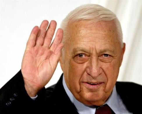 Israeli Prime Minister Ariel Sharon gestures at the end of his Likud Party's women conference in Tel Aviv in this March 10, 2005