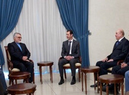 Syrian intelligence chief, Ali Mamlouk (right) made his first public appearance after rumours of a coup. In his video grab he is seen with President Assad (Centre) and Iranian Shura Council's Committee for Foreign Policy and National Security Alaeddin Bo
