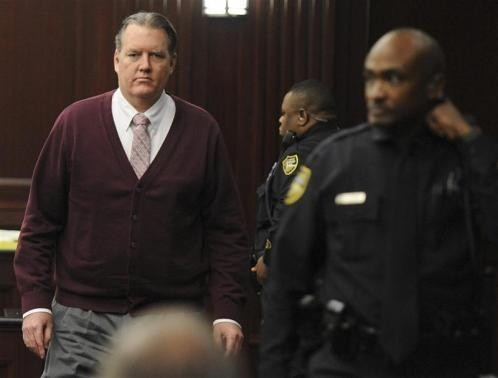 Michael Dunn returns to the courtroom during jury deliberations in his murder trial over the killing of Jordan Davis, in Jacksonville, Florida February 13, 2014.