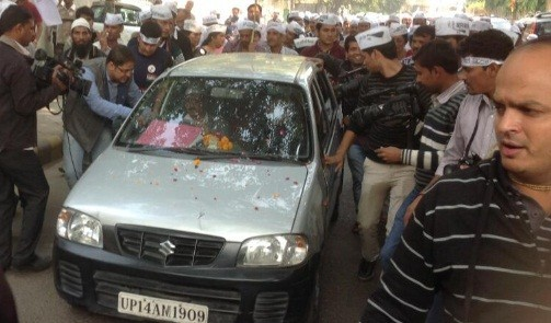 AAP supporters surround Arvind Kejriwal's car as he left for filing his nomination for upcoming Delhi assembly polls