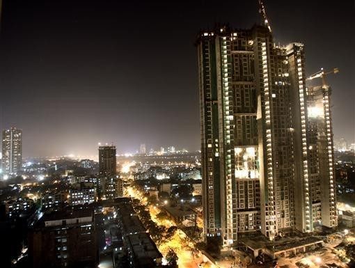 Mumbai Topped the list of World's cheapest cities of 2013. A high-rise building is lit up during construction in Mumbai December 22, 2006( Reuters)