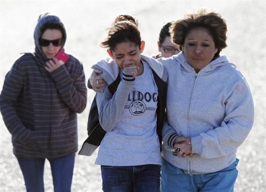 Students are reunited with families following an early morning shooting at Berrendo Middle School in Roswell, New Mexico, January 14, 2014.