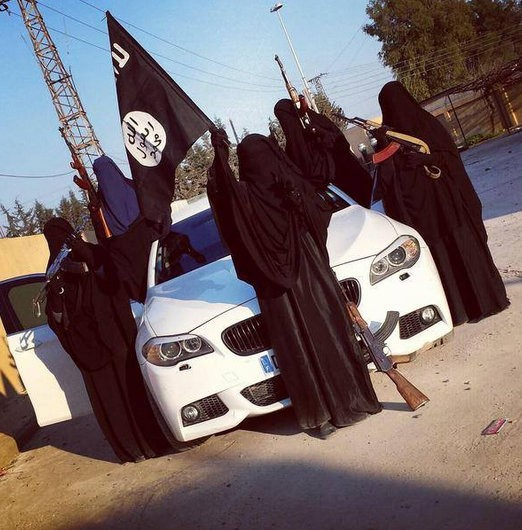 wives and daughters of dead Australian Isis terrorists Suhan Rahman and Mahmoud Abdullatif pose with AK 47 besides a BMW M5.