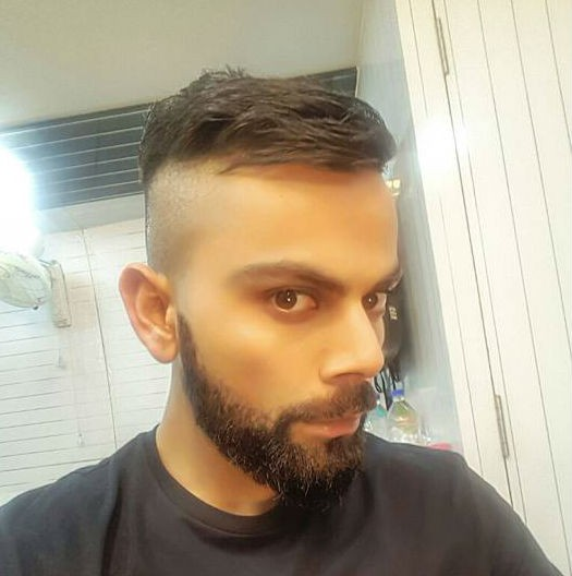 Virat Kohli,Kohli,Virat Kohli flaunts new hairstyle,Kohli flaunts new hairstyle,Virat Kohli new hairstyle,Kohli new hairstyle,Virat Kohli hairstyle,Kohli hairstyle,New Zealand series,India vs New Zealand,New Zealand vs India,Virat Kohli pics,Virat Kohli i