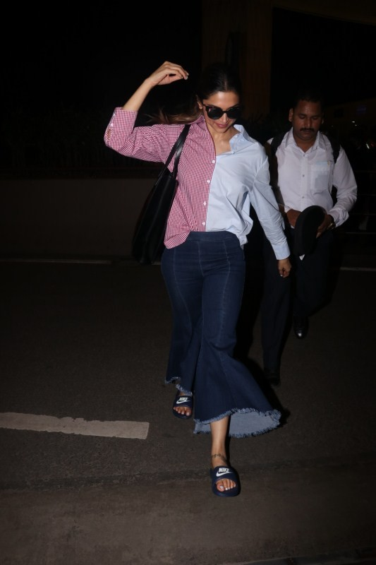 Deepika Padukone spotted at airport,Sunny Leone spotted at airport,Deepika Padukone at airport,Sunny Leone at airport,Deepika Padukone,Sunny Leone