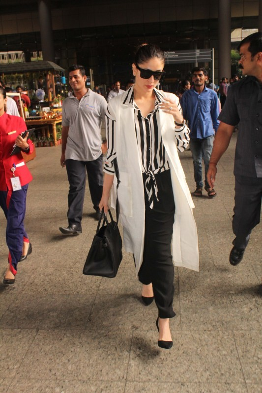 Deepika Padukone and Kareena Kapoor,Deepika Padukone,Kareena Kapoor,Deepika Padukone spotted at airport,Kareena Kapoor spotted at airport,Deepika Padukone pics,Deepika Padukone images,Deepika Padukone stills,Kareena Kapoor pics,Kareena Kapoor images,Karee