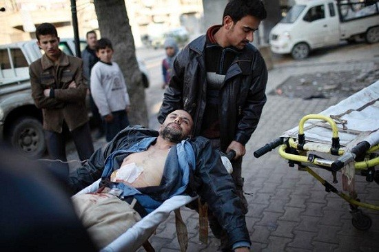 Free Syrian Army fighters carry their wounded comrade who was shot during a fight/Reuters File