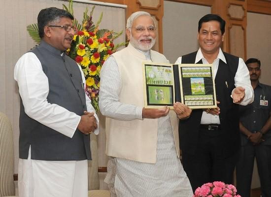 Prime Minister Narendra Modi releases commemorative postage stamps on the 2014 FIFA World Cup, in New Delhi on June 12, 2014.