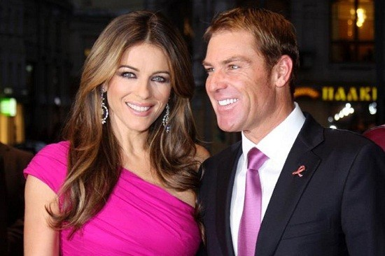 Liz Hurley and Shane Warne/Reuters