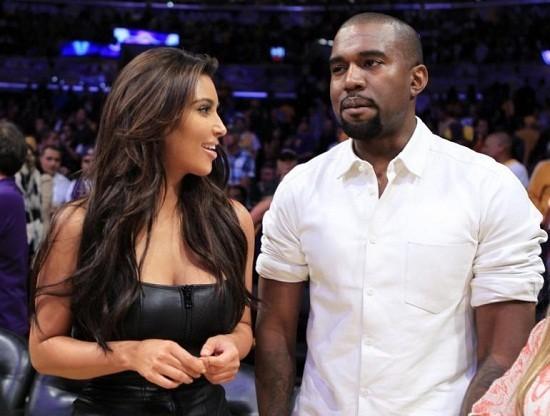 Rapper Kanye West with wife Kim Kardashian/Reuters